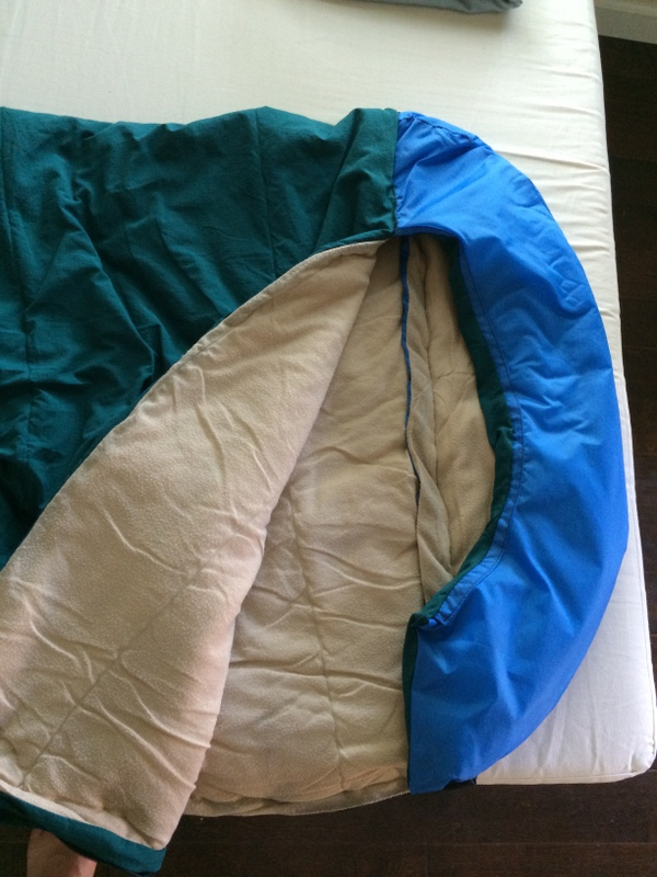 hood is crudely stitched to the top of the tapered bag