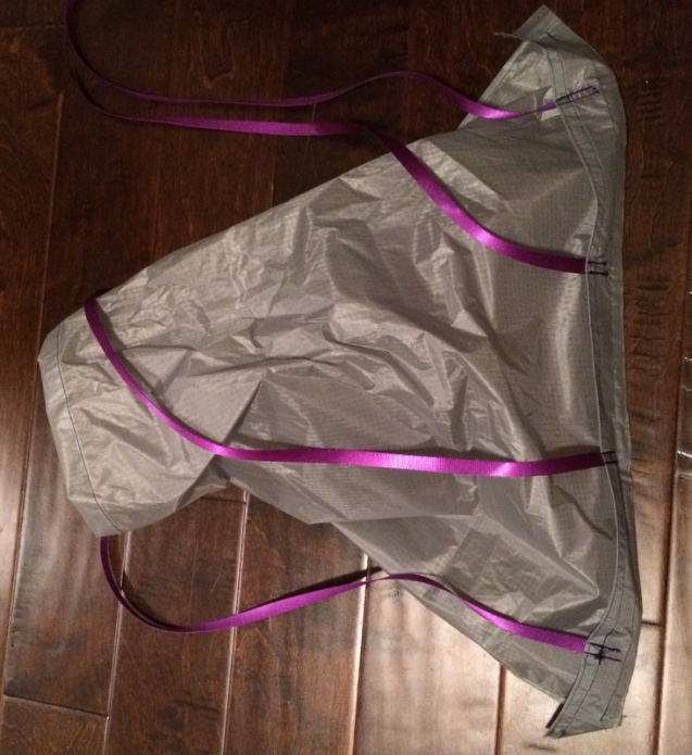 skirt with webbing tentacles attached to the bag body