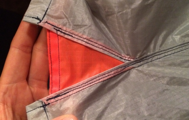 finally, the body becomes a tube. Starting at the strain relief triangle, the edges are sewn together.
