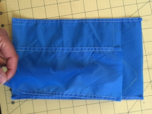 middle layer sewn to the inner and outer layer