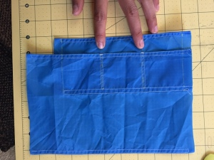two sets of stitches divide up the fabric to form the card pockets