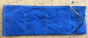 with the wallet still inside out I sewed the triangular shape of the velcro tab
